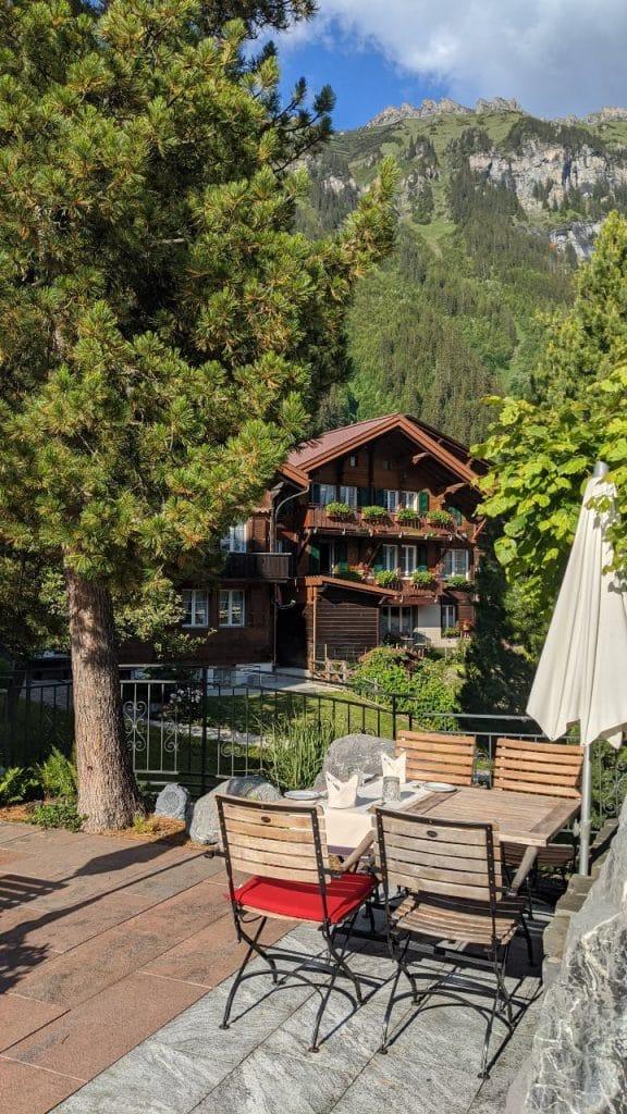 Our dining table on the terrace of hotel Schönegg in Wengen, Switzerland. In the background mount Männlichen.
