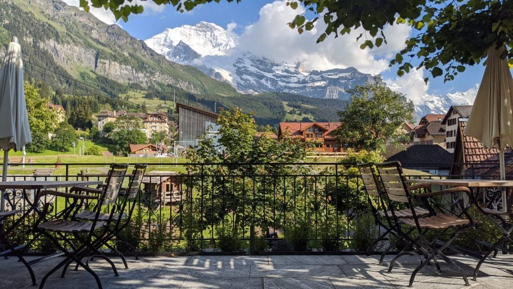 The terrace of hotel Schoenegg in Wengen, Switzerland with a view to mount Jungfrau