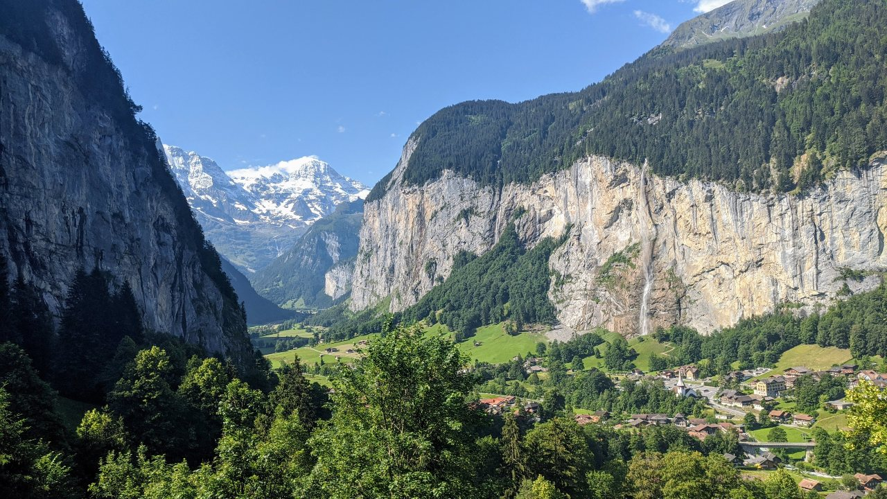 View of Lauterbrunnen valley and village, Switzerland. Waterfalls and snowy mountain peaks.