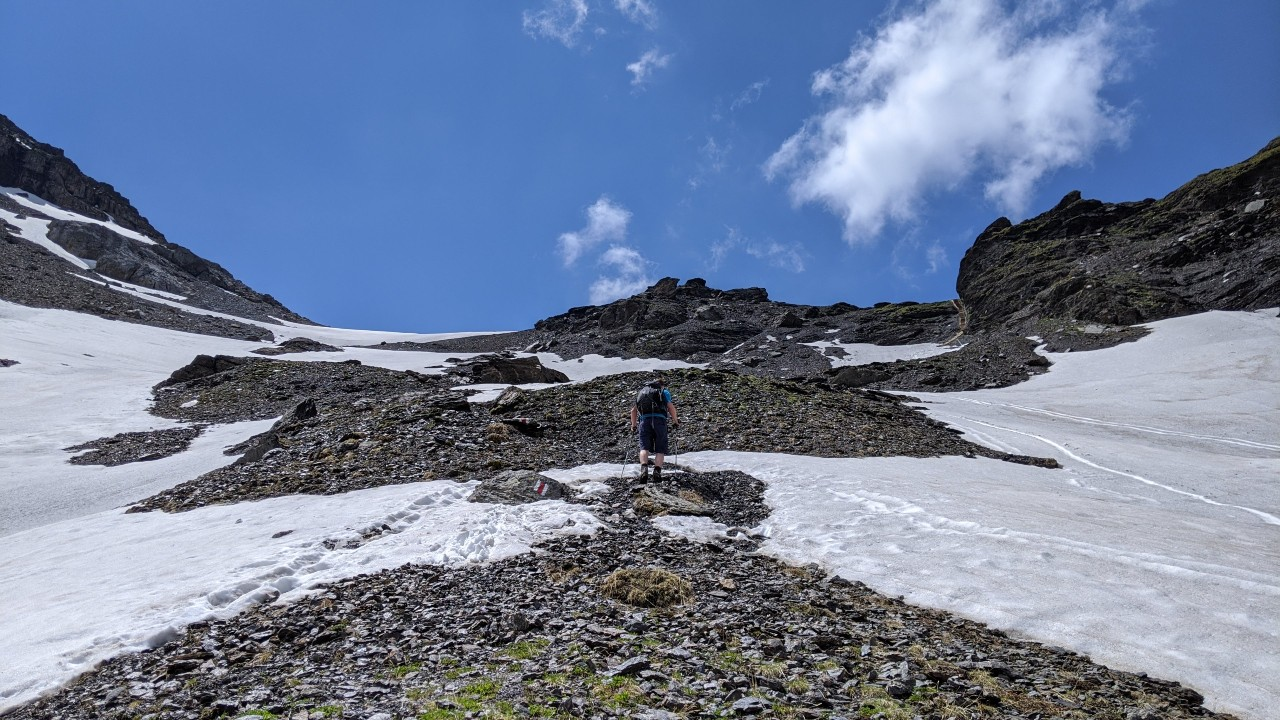 Matthias hiking through the snow to Sefinenfurgge mountain pass