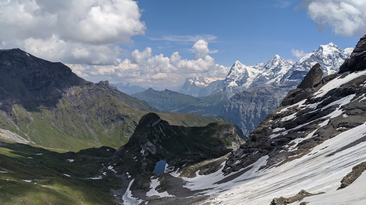 View of Schilthorn (left), the Eiger, the Mönch and the Jungfrau from Via Alpina hiking trail to Sefinenfurgge mountain pass.