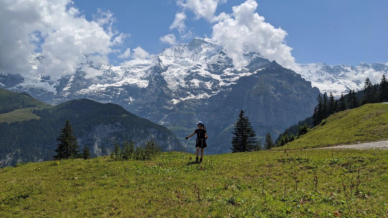 Solène hiking on Via Alpina to Mürren. In the background mount Jungfrau.
