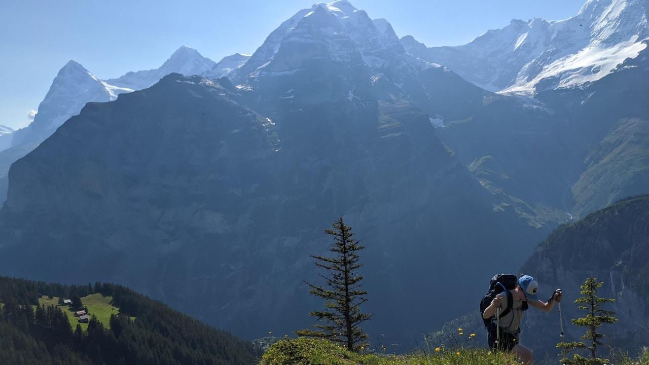 Solène hiking on the Via Alpina from Mürren to Sefinenfurgge. In the background mount Jungfrau massif.