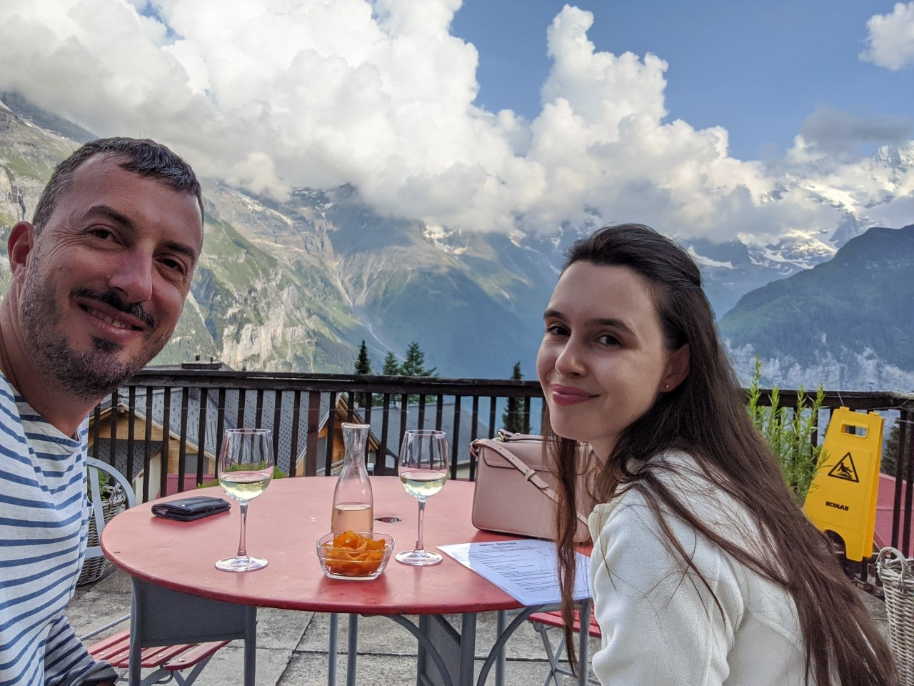 Solène (on the right) and Matthias having an aperitif on the balcony of hotel Regina in Mürren, Switzerland